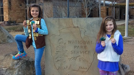 two girls with Junior Ranger badges
