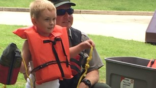 ranger and boy with life jacket