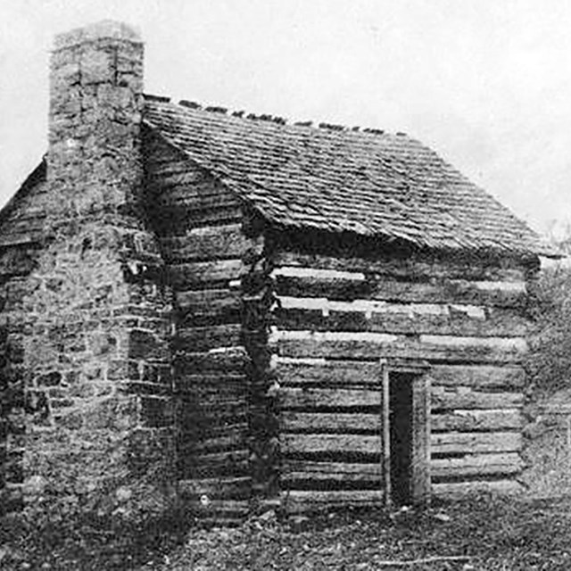 historic photo of a log cabin