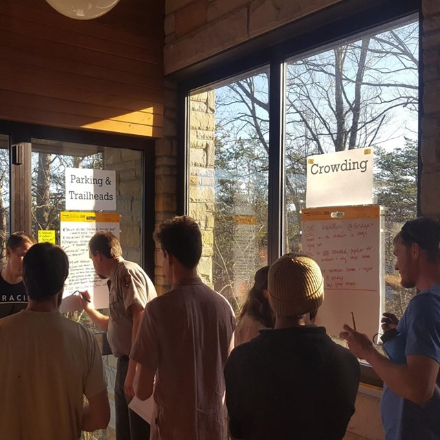 people engaged in a meeting in a park visitor center