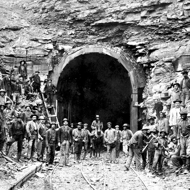 workers digging tunnel