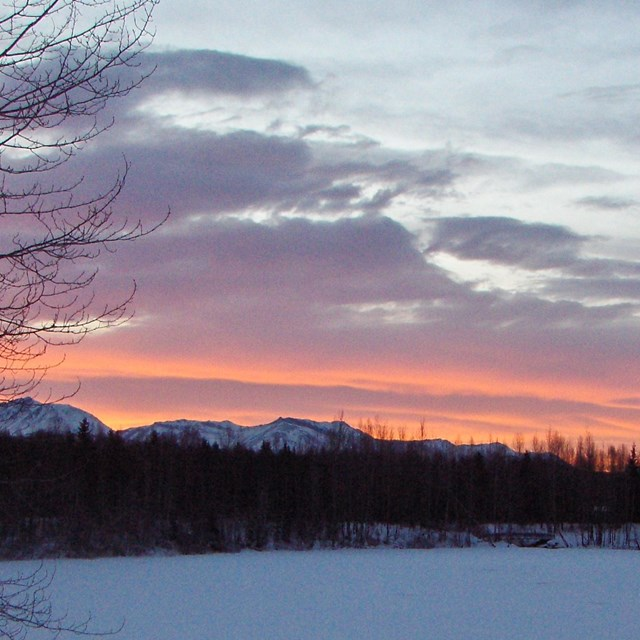 Sunset over a snow covered lake in Southcentral Alaska