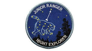 The Junior Ranger Night Explorer badge features an embroidered Ursa Major constellation