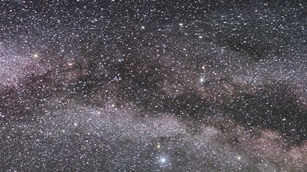 Cropped night sky view of the Milky Way and constellations