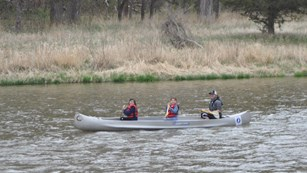 Two children and an adult enjoy canoeing on the Niobrara National Scenic River.