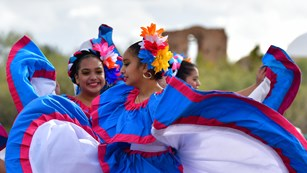 Folklorico dancers near mission ruins