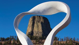 Smoke sculpture framing a butte-like geological formation