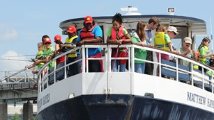 Group of kids on a boat stern