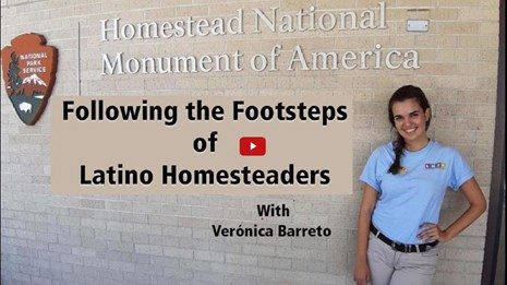 Video preview image of an intern standing next to a visitor center entrance