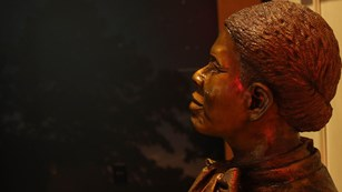 Face of a metal statue of Harriet Tubman