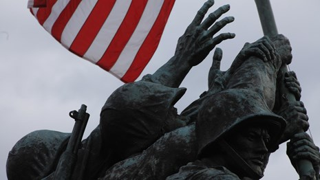 Statue of Marines' hands holding up a US flag