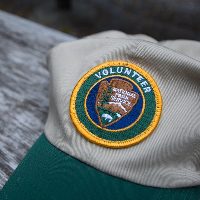 Baseball cap with an NPS Volunteer logo patch