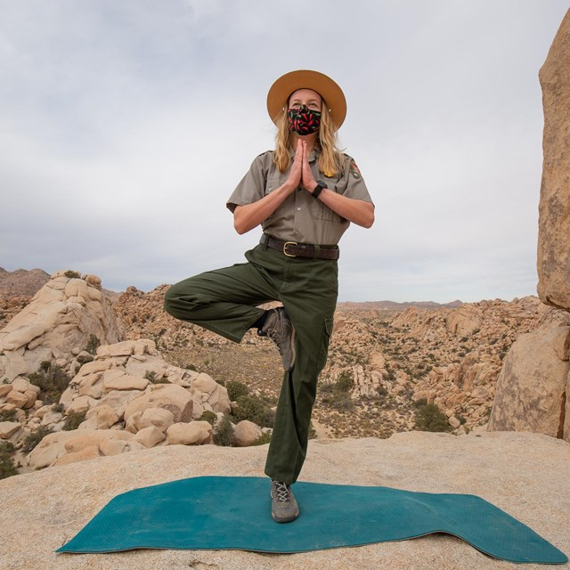 Ranger doing a yoga pose in the desert