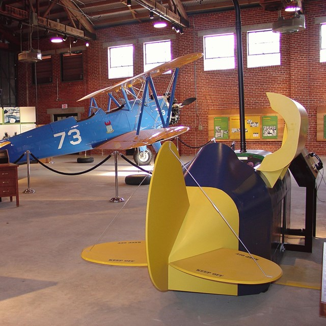 Yellow plane in a hanger