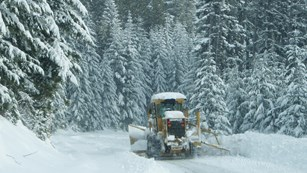 Snow plow works to clear heavy snow on Hurricane Ridge Road.