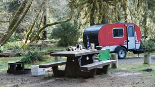 Red trailer set up in the Hoh campground.