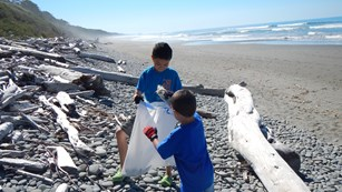 Kids collecting marine debris