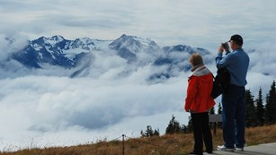 Two people overlook mountain vistas at Hurricane Ridge