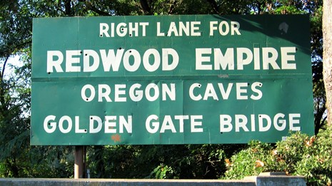 Redwoods, Oregon Caves, and Golden Gate road sign
