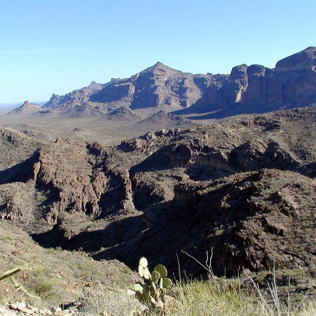 Picture of two mountain ranges- the jagged Diablo Mountains in the background