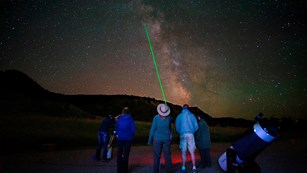 Ranger uses a laser pointer to highlight stars in the sky.