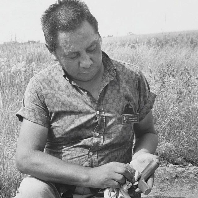 A photo of a carver at Pipestone National Monument