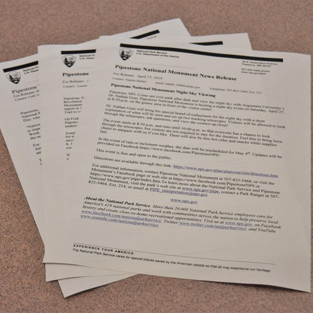 3 sheets of press releases on a table