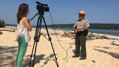 Park Ranger being interviewed by a local reporter