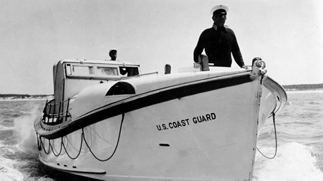 Historic photo of Coast Guard Vessel and her pilot on Lake Superior