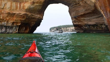 Kayak along the Pictured Rocks shoreline.