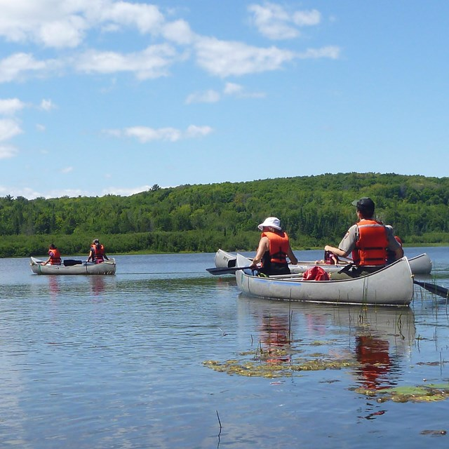 Visitors canoeing across Beaver Lake