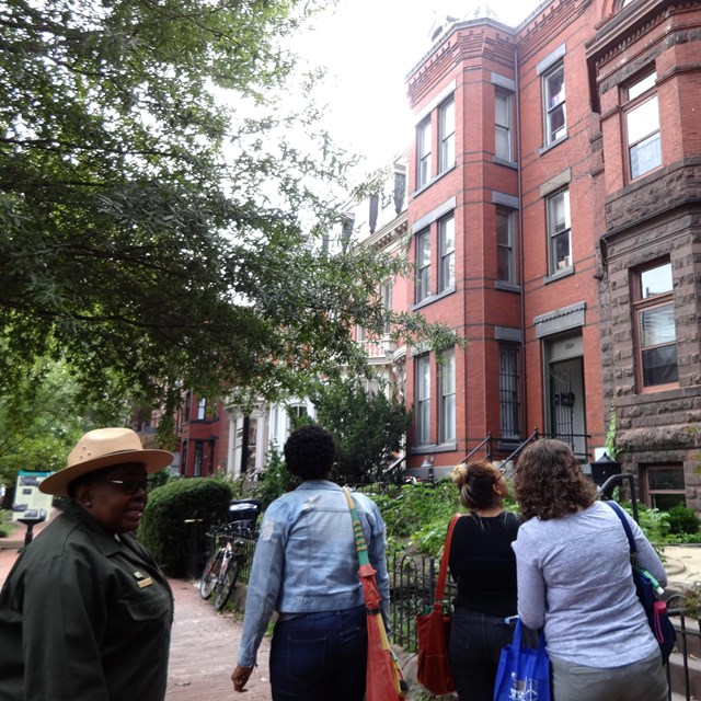 Park ranger leading walking tour of city neighborhood