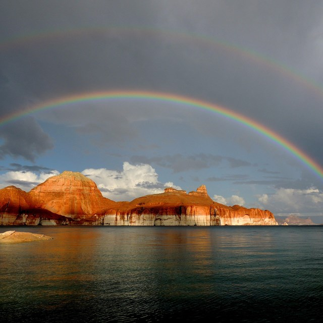 Double rainbow arches over the buttes in Padre Bay on Lake Powell