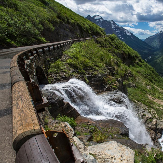 Waterfall next to a road on a mountain