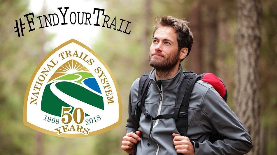 A hiker with the National Trail system logo.