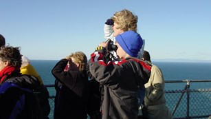 A group of visitors watching for gray whales.