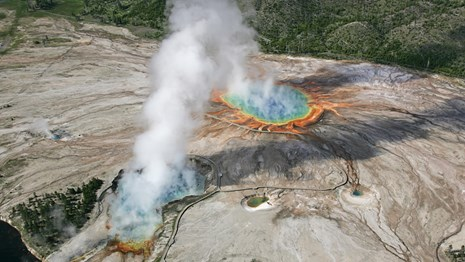 Aerial view of rainbow colored hot springs.