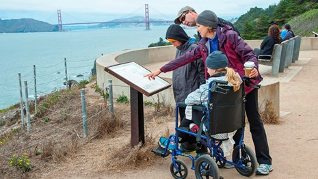 Park visitor using wheelchair accessible trail at Land's End