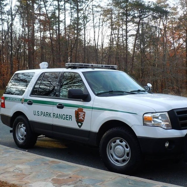 Law Enforcement vehicle in the circle of the Visitor Center