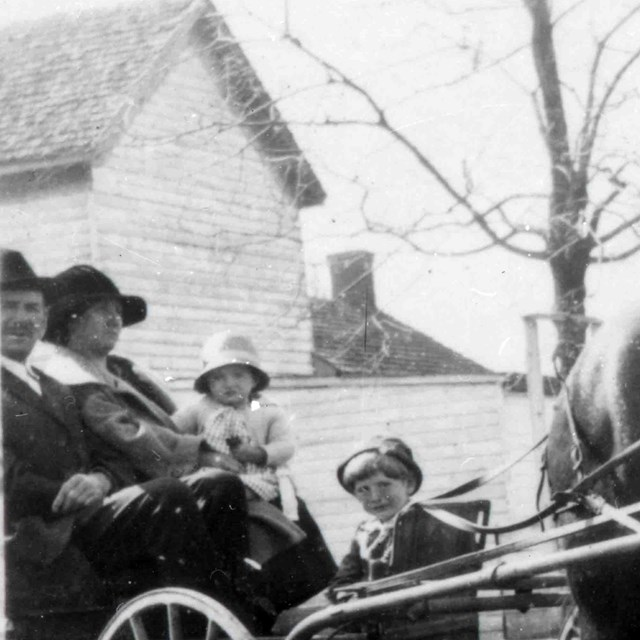 The Taylor Family being pulled by a horse carriage