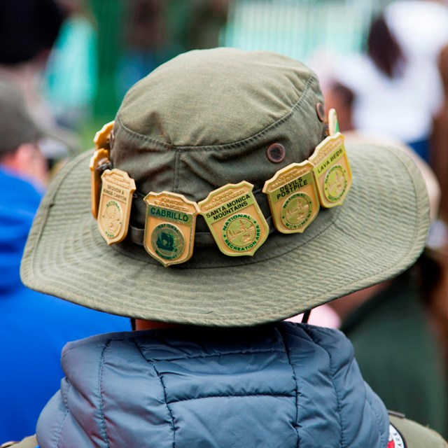 Junior Ranger badges line the brim of a child's Junior Ranger Hat.