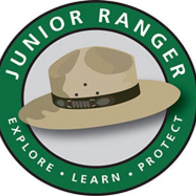 A drawing of a park ranger hat and the text