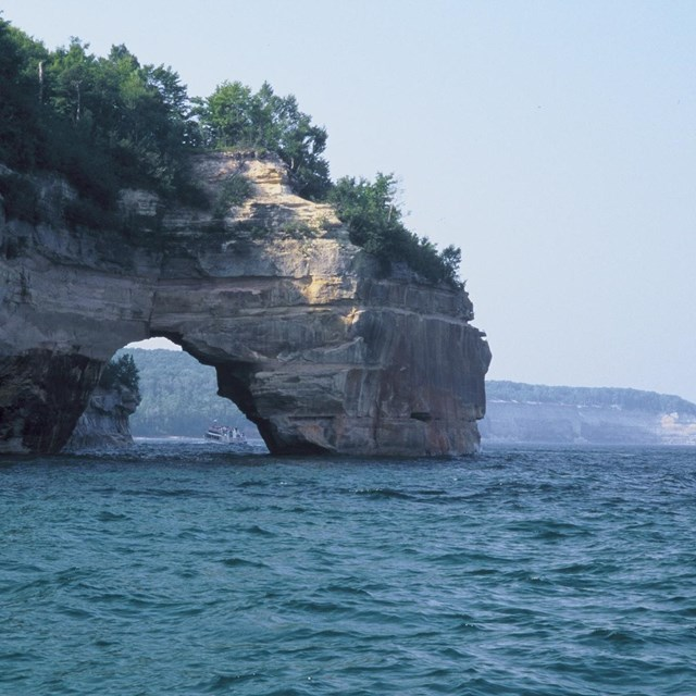 Little Portal Point along the Pictured Rocks, as viewed heading west on a hazy day.