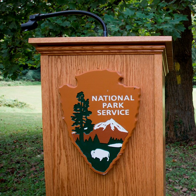 Podium with the National Park Service logo on it.