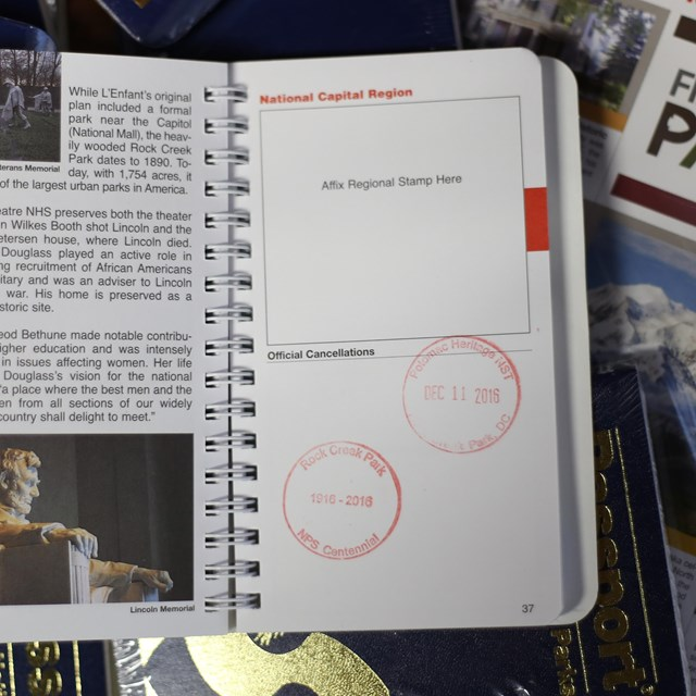An image of a small National Park Service passport book, open to the National Capital Region page.