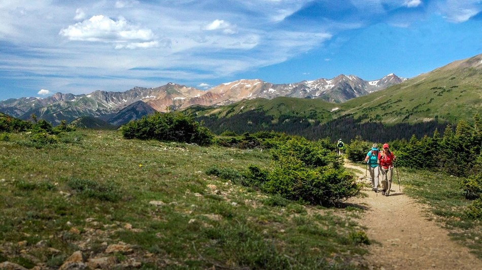 Hikers on the Ute Trail on the tundra in Rocky Mountain National Park.