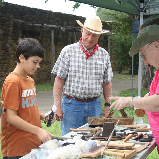Volunteer speaks with youth at Archaeology Day