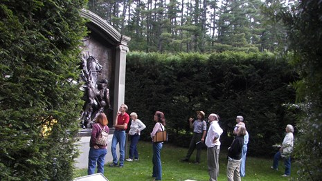 Visitors looking at the Shaw Memorial in the Bowling Green