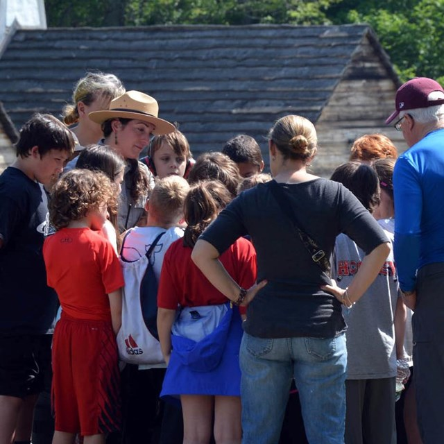 A ranger speaking to a school group at the Saugus Iron Works