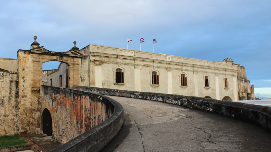Steep ramp leads to historic entrance to Castillo San Cristóbal.